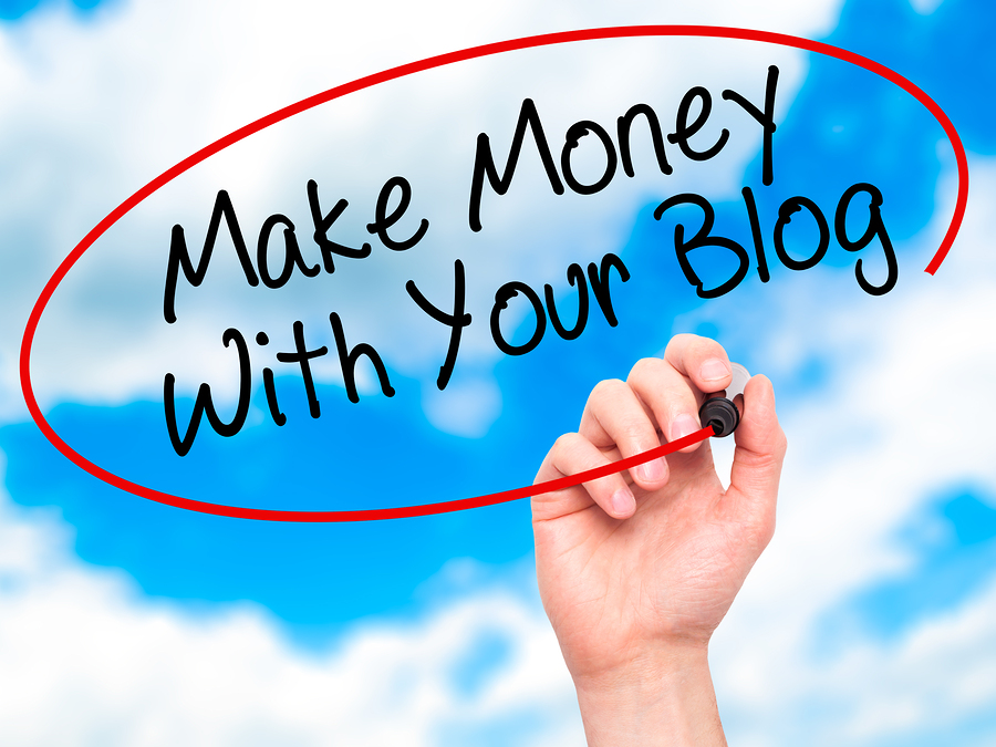 Man Hand writing Make Money With Your Blog with black marker on